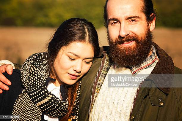 multi-racial couple on an autumn walk - surrey england stock photos and pictures