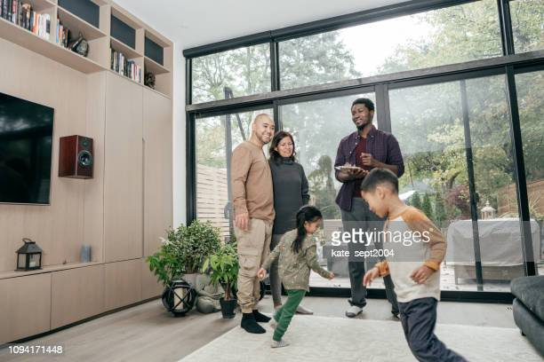 multiracial family getting home consultation - real estate stock pictures, royalty-free photos & images