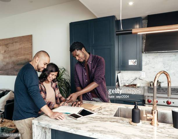 multiracial family getting home consultation - building contractor stock pictures, royalty-free photos & images