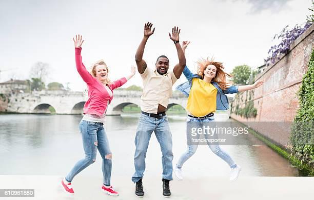 multiracial friends jumping
