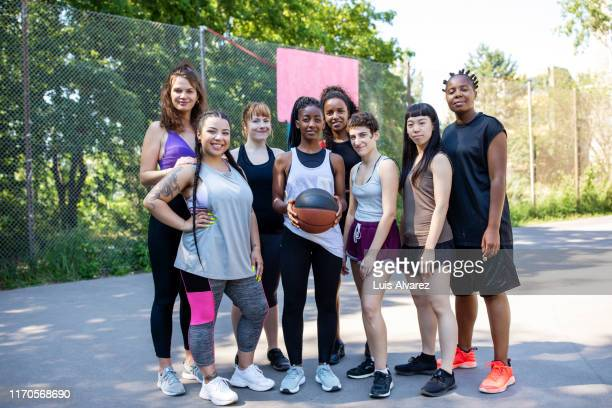 multiracial friends on a basketball court - women's basketball stock pictures, royalty-free photos & images