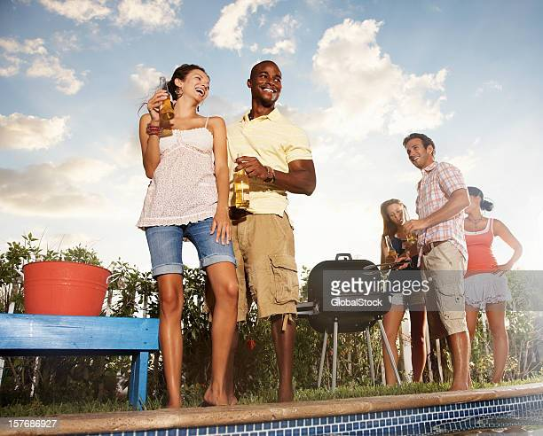 Multiracial friends with beer and barbeque on a vacation