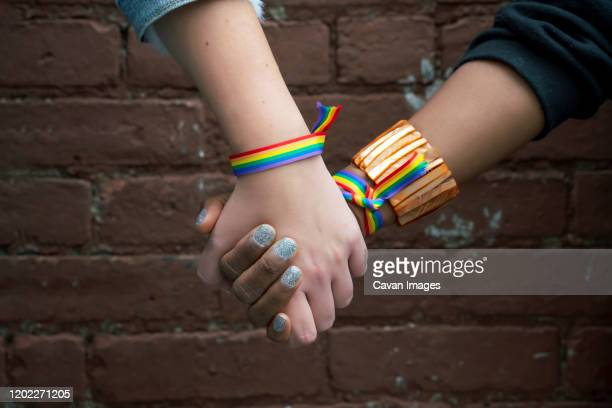 multiracial gay couple holding hands in brooklyn -  lgbtqi ストックフォトと画像