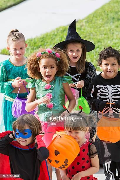 Multi-racial group of children in halloween costumes