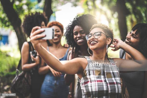 multiracial group of friends taking selfie - the bronx stock pictures, royalty-free photos & images