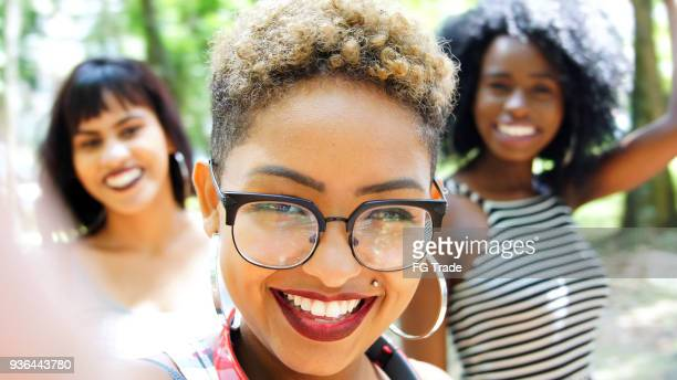 multiracial group of friends taking selfie - camera girls stock photos and pictures