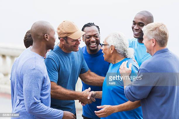 multi-racial group of men,   shaking hands - sports team event stock photos and pictures