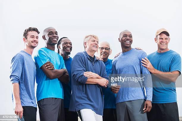 Multiracial group of men wearing blue shirts