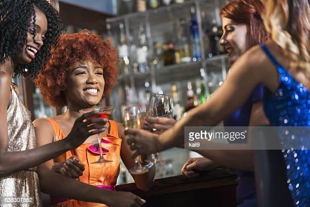 Multiracial group of women at a bar