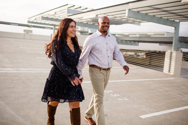 Multiracial Late Forties Couple Walking on Rooftop in San Diego