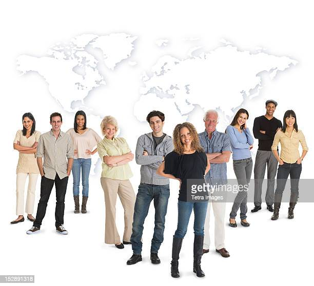 Multi-racial mixed race group of people posing together, world map in background