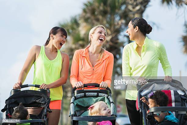 multi-racial mothers with babies in jogging strollers - pushchair stock pictures, royalty-free photos & images