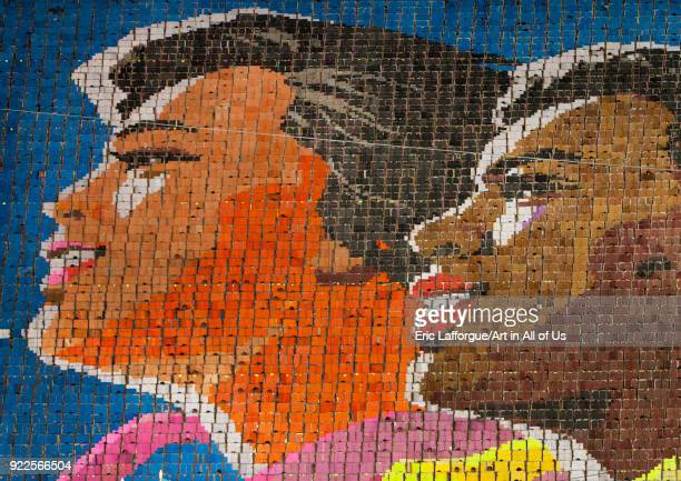 Multiracial people made by children pixels holding up colored boards during Arirang mass games in may day stadium Pyongan Province Pyongyang North...