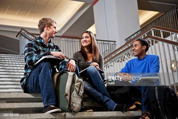 Multiracial students  on steps of school building