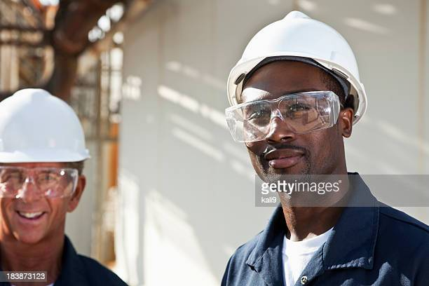 multiracial workers at industrial plant - protective eyewear stock photos and pictures