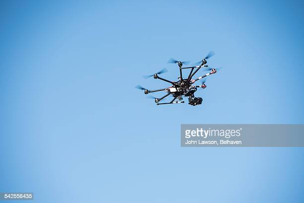 multirotor drone (octocopter) against a blue sky - オクトコプター ストックフォトと画像