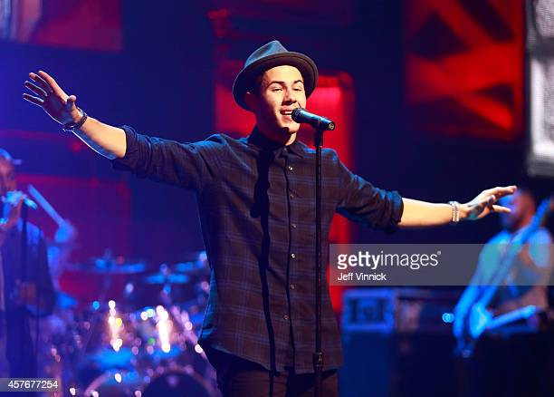 Multi-talented recording artist and actor Nick Jonas performs the hit song 'Jealous' for 20,000 students at We Day at Rogers Arena on Wednesday...