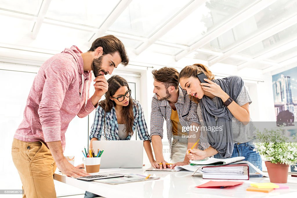 Multi-tasking creative people. : Stock Photo