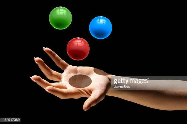 Multitasking;  Juggling Three Colorful Balls in One Hand
