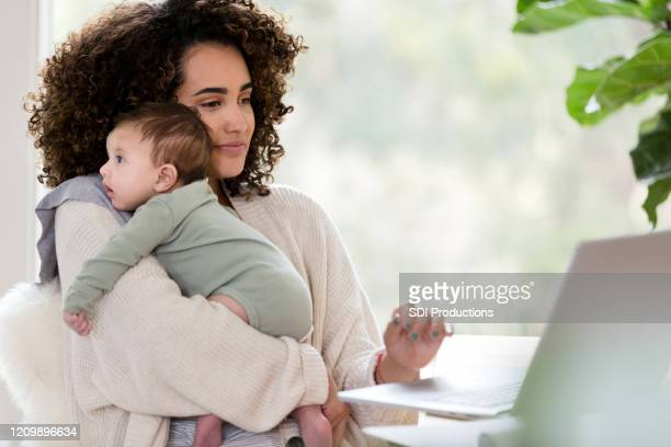 multi-tasking mom at work - child care stock pictures, royalty-free photos & images