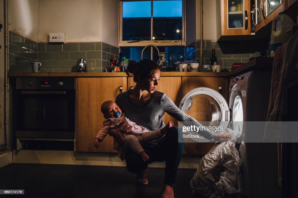 Multi-Tasking moeder : Stockfoto