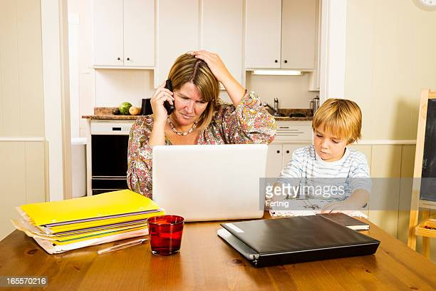 Multi-tasking mother working at home