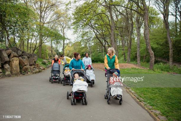 multi-tasking mothers - carriage stock pictures, royalty-free photos & images