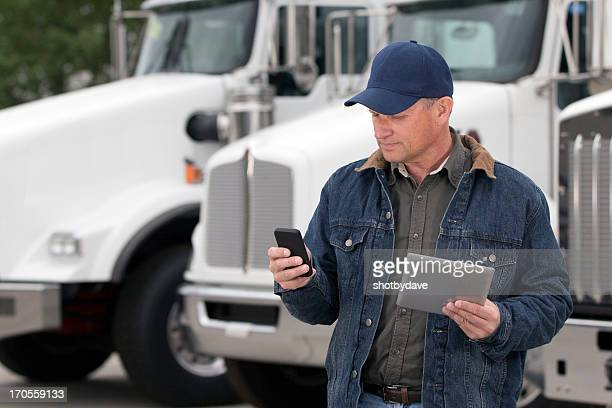 multitasking truck driver - trucking stock pictures, royalty-free photos & images