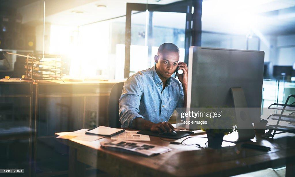 Multitasking will help him reach that deadline : Stock Photo