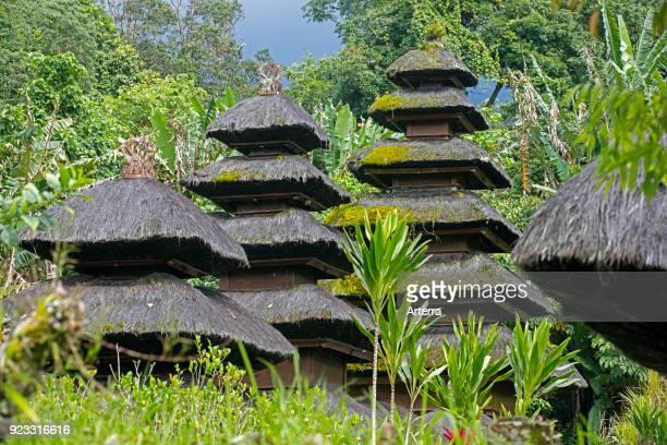Multitiered meru towers at Pura Luhur Batukaru Hindu temple in Tabanan on southern slope of Mount Batukaru volcano on the island Bali Indonesia