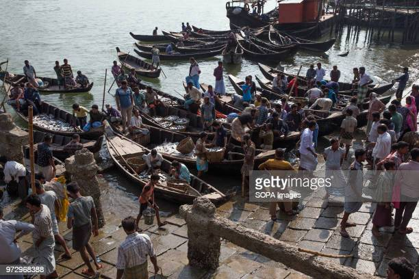 COX'S BAZAR BANGLADESH Multitudes of fishermen and boats gather at Cox's Bazar fish market ready to get the best price for their catches Cox's Bazar...