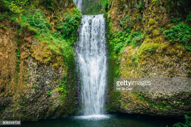 multnomah falls over rocky hillside, portland, oregon, united states - multnomah falls stock photos and pictures