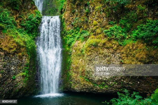 Multnomah Falls over rocky hillside, Portland, Oregon, United States
