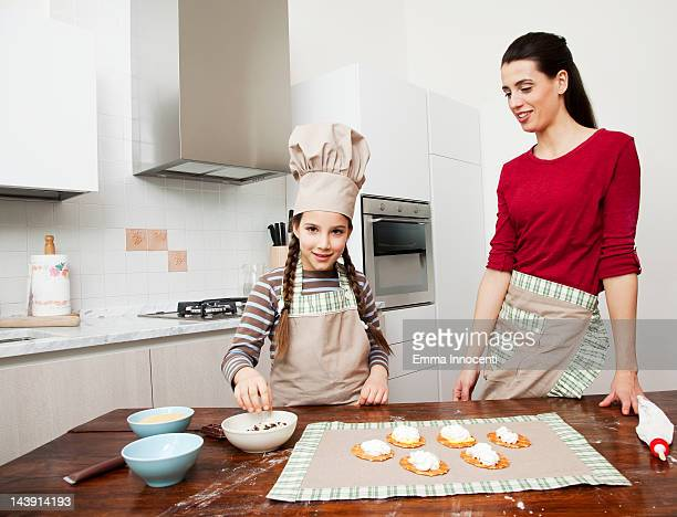 mum and daughter decorating cookies together