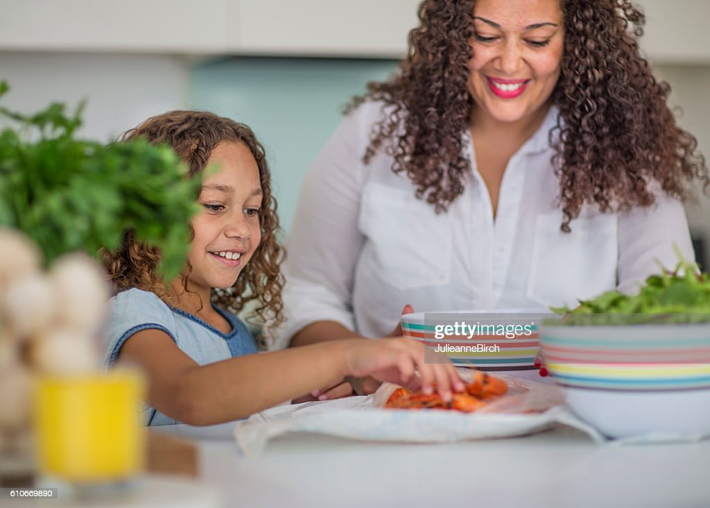 Mum and daughter in the kitchen : Stock Photo