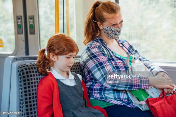 mum and daughter - train interior stock pictures, royalty-free photos & images