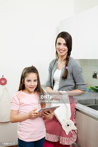 mum and daughter portrait with digital tablet