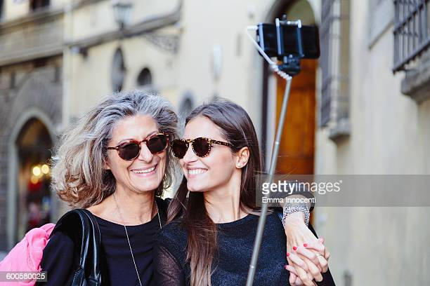 Mum and daughter taking photo with selfie stick