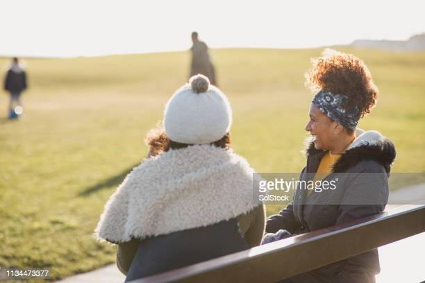 mum and grandma catching up - whitley bay stock pictures, royalty-free photos & images
