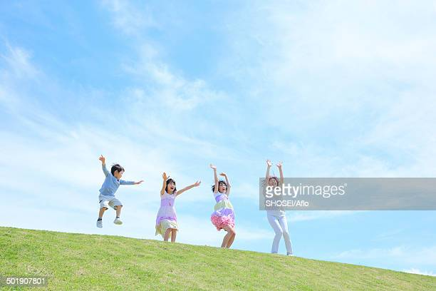 Mum and kids on a hill, Japan