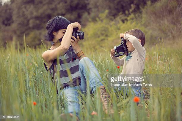 Mum and son taking pictures of each other