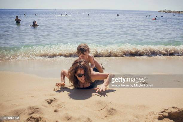 Mum and toddler playing at the beach