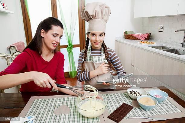 mum, daughter, baking, digital tablet, kitchen