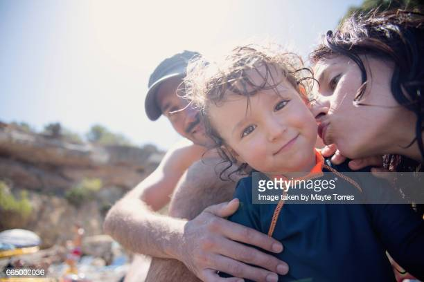 mum kissing boy at the beach - hot mom stock photos and pictures