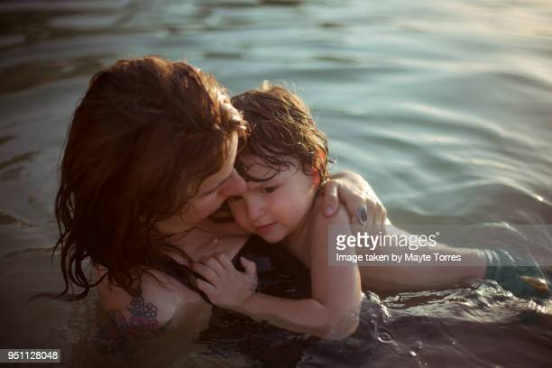 Mum protecting toddler in the sea