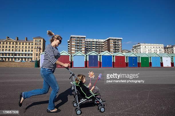 Mum pushing her son along in buggy