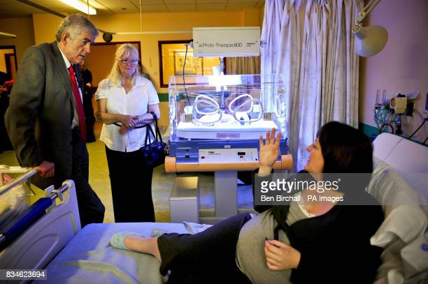 Mum Rachel Longley with her new baby girl Hannah Longley in her incubator being treated for jaundice chats with First Minister of the National...