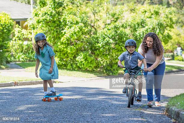 Mum teaching her son to ride a bike