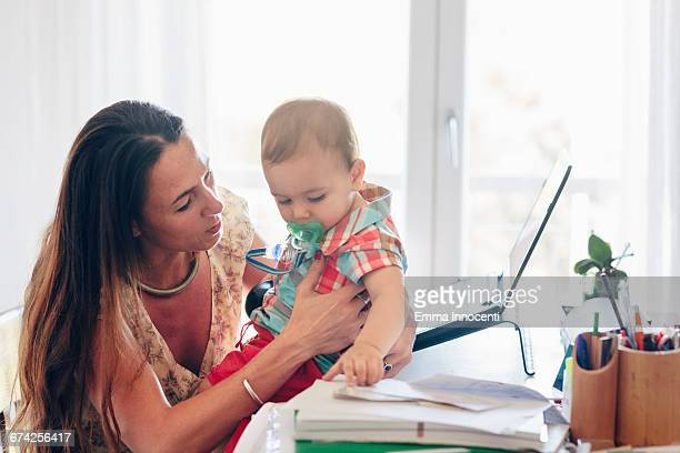 Mum with toddler working at her office