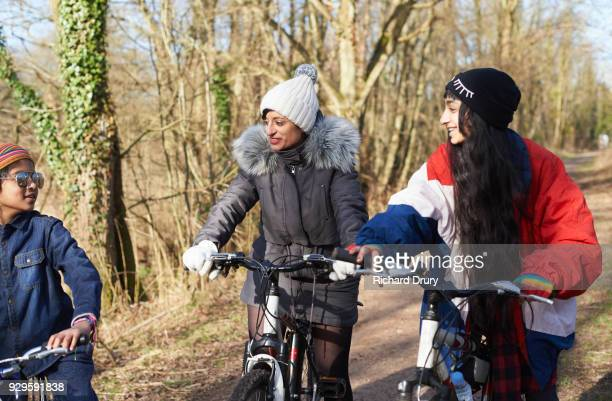 Mum with two children on cycle track